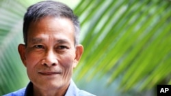 "FILE - Vietnamese blogger Nguyen Van Hai, pictured in October 2014, says it's time ""for everyone to sit down to find ways to restore"" his country, but ""everyone must have a voice in the process."""
