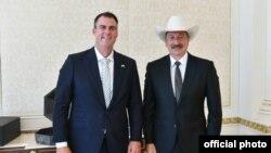 Azərbaycan prezidenti İlham Əliyev və ABŞ-ın Oklahoma ştatının qubernatoru Kevin Stitt