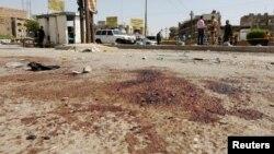 27일 자살폭탄 공격이 발생한 이라크 수도 바그다드 시내 사건 현장에 사상자들이 흘린 핏자국이 남아있다.