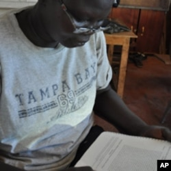 Esther Bagirasas, who plays the queen, learning her lines, Juba, South Sudan, April 4, 2012.