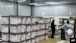 Election officials arrange ballot boxes at a counting center in Kosovo Polje, Dec 13, 2010