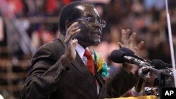 FILE: Zimbabwean President Robert Mugabe attends a meeting with the country's war veterans in Harare, April, 7, 2016.