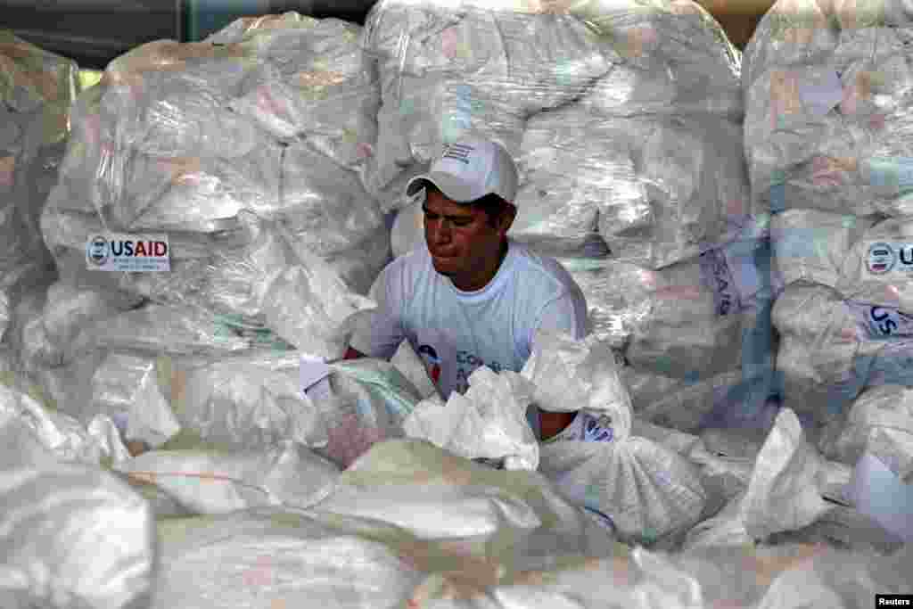 A worker organizes humanitarian aid for Venezuela at a warehouse near the Tienditas cross-border bridge between Colombia and Venezuela, in Cucuta, Colombia.