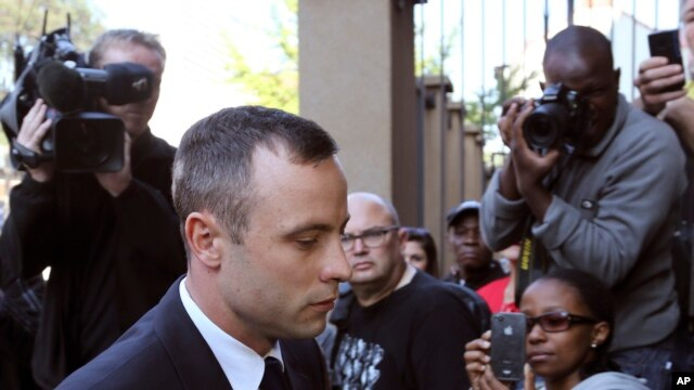 Oscar Pistorius, arrives at the high court in Pretoria, South Africa, April 15, 2014.