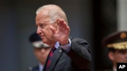 U.S. Vice President Joe Biden waves to photographers at the National Palace in Guatemala City, June 20, 2014.