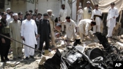 A government official says a bomb exploded in a market in northwestern Pakistan close to the Afghan border, killing scores of people, July 26, 2012.