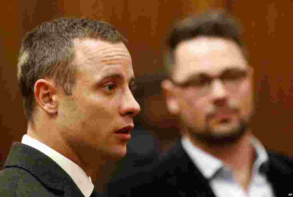 Oscar Pistorius listens as a court ruling is handed down. The ruling stated that he would undergo psychiatric evaluation in Pretoria, South Africa, May 20, 2014.