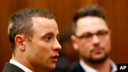 Oscar Pistorius, dont le procès reprend lundi en Afrique du Sud (Photo AP)