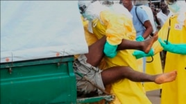 Health workers push an Ebola patient who escaped from quarantine in Monrovia's Elwa hospital into an ambulance in the centre of Paynesville, Sept. 1, 2014.
