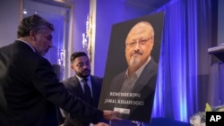 Mongi Dhaouadi (L) and Ahmed Bedier set up an image of slain Saudi journalist Jamal Khashoggi before an event to remember Khashoggi, a columnist for The Washington Post who was killed inside the Saudi Consulate in Istanbul on Oct. 2, in Washington, Nov. 2