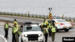 Canadian police check a car next to the red zone security perimeter around the Manoir Richelieu ahead of G7 Summit in La Malbaie, Canada, June 5, 2018.