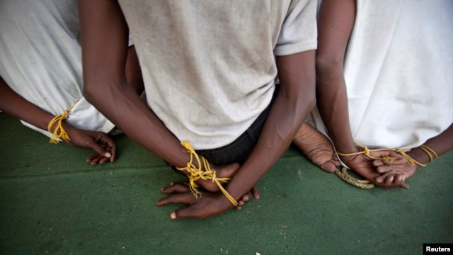 Somali pirates have released 11 hostages, the U.N. reports. Shown here are suspected Somali pirates captured on the Indian Ocean by the Indian Navy and Coast Guard, Feb. 10, 2011.