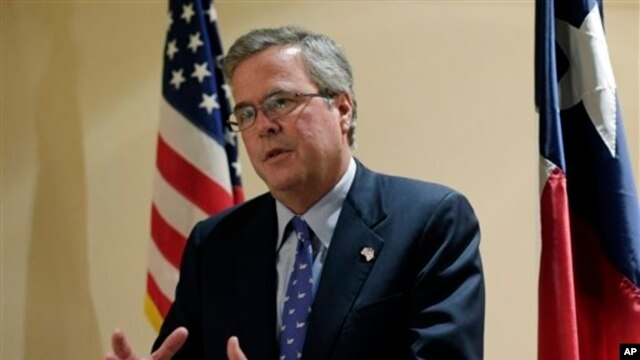 Former Florida Governor Jeb Bush talks with the media following his address on education to the Texas Business Leadership Council in Austin, Texas.