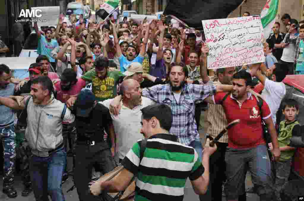 This citizen journalism image provided by Aleppo Media Center AMC, shows anti-Syrian regime protesters chanting slogans during a demonstration in Aleppo, Sept. 6, 2013.