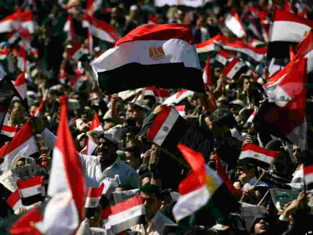 On February 18, 2011, tens of thousands of Egyptians, some waving the national flag, gather in Tahrir square to pray and celebrate the fall of the regime of former President Hosni Mubarak, and to maintain pressure on the current military rulers. (AP)