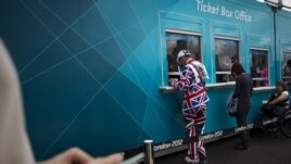 Visitors by their tickets for the Olympic Park at the 2012 Summer Olympics, London, July 29, 2012.