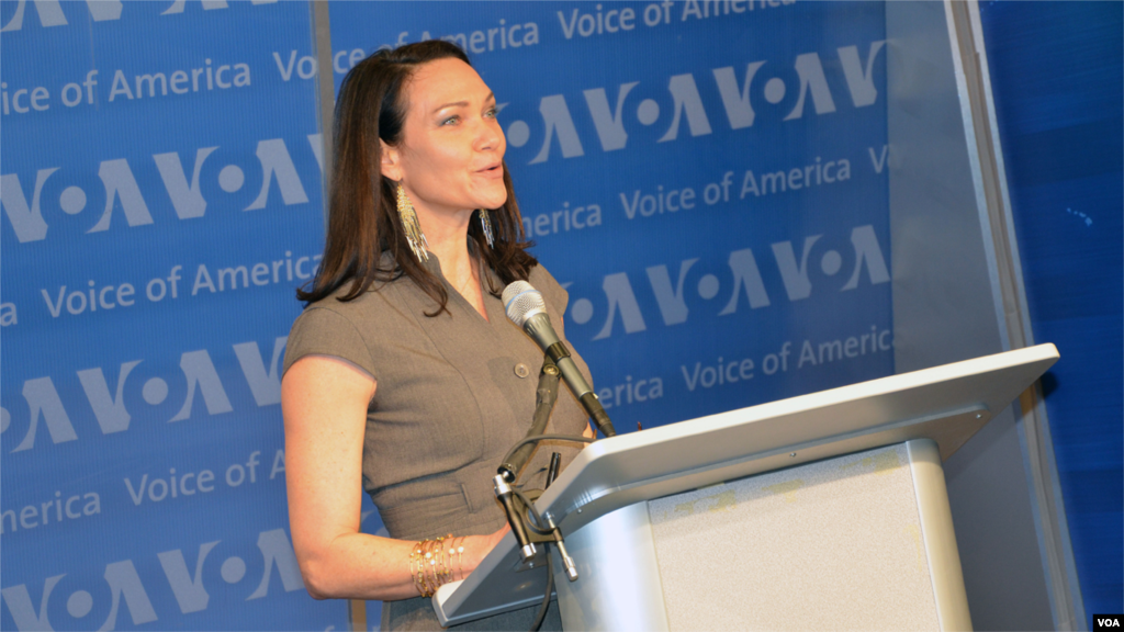 """Heather Maxwell, who took over for Leo as host of """"Music Time in Africa"""" in 2012, speaks at the studio dedication ceremony."""
