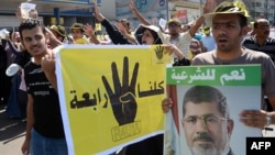 Supporters of Egypt's ousted Islamist president Mohamed Morsi take part in a rally in the coastal city of Alexandria in this September 20, 2013, file photo.
