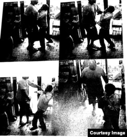 Ferguson police documents say these are surveillance images of Michael Brown pushing a convenience store worker shortly before Brown was shot and killed by police Officer Darren Wilson.