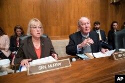Sen. Patty Murray, D-Wash., and Sen. Lamar Alexander, R-Tenn., meet before the start of a hearing on Capitol Hill in Washington, Oct. 18, 2017.