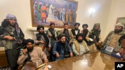 Taliban fighters take control of Afghanistan's presidential palace after President Ashraf Ghani left the country, in Kabul, Afghanistan, Aug. 15, 2021.