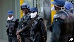 FILE: Riot police wear face masks on the streets of Harare, Zimbabwe, Tuesday, March 31, 2020.