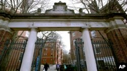 FILE - In this Dec. 13, 2018, file photo, a gate opens to the Harvard University campus in Cambridge, Mass. The U.S. Education Department said Wednesday, Feb. 12, 2020, it is investigating foreign gifts made to Harvard and Yale as part of a broader…
