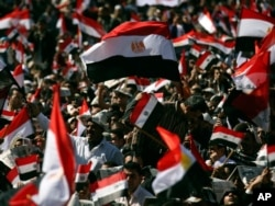 FILE On Feb 18, 2011, tens of thousands of Egyptians, some waving the national flag, gather in Tahrir square to pray and celebrate the fall of the regime of former President Hosni Mubarak, and to maintain pressure on the current military rulers.