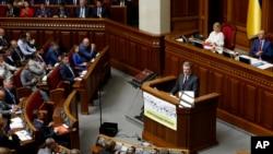 Ukrainian President Petro Poroshenko addresses parliament during its opening session in Kyiv, Ukraine, Sept. 6, 2016. Poroshenko has set both NATO and EU membership as strategic goals for Ukraine.