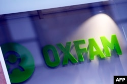 FILE - An Oxfam logo is seen on one of the organization's bookshops in Glasgow, Scotland, Feb. 10, 2018.