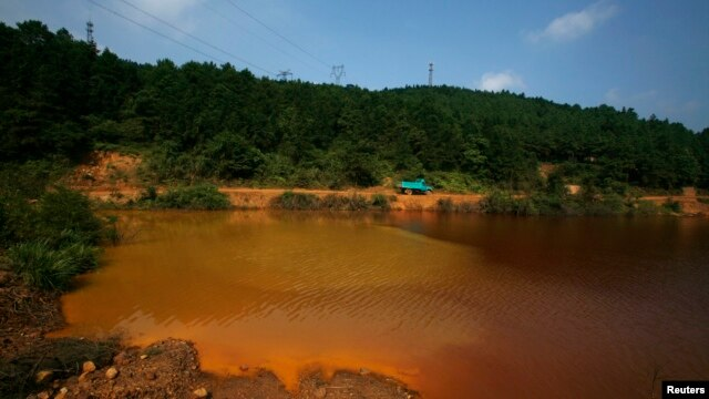 A contaminated lake is seen near Dabaoshan in the northern part of China's Guangdong province August 27, 2009.