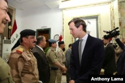 FILE - Jared Kushner, U.S. President Donald Trump's son-in-law and senior adviser, arrives at the Ministry of Defense, in Baghdad, Iraq, April 3, 2017.