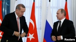 FILE - Russian President Vladimir Putin (R) and Turkish President Recep Tayyip Erdogan attend a news conference following their meeting in St. Petersburg, Russia, Aug. 9, 2016. Both men are scheduled to meet in Moscow Friday.