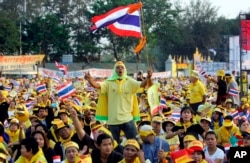 FILE - In this Feb. 4, 2006, file photo, Thai protesters wave flags and cheer during a rally opposing Prime Minister Thaksin Shinawatra at the Royal Plaza in Bangkok, Thailand. (AP Photo/Sakchai Lalit, File)