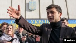 FILE - Volodymyr Zelenskiy, a candidate in Ukraine's upcoming presidential elections who came to fame as TV comic, speaks after submitting registration documents to the Central Election Commission, in Kyiv, Ukraine, Jan. 25, 2019. Zelenskiy is the front-runner in many polls.