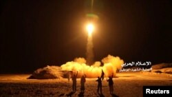 FILE - A photo distributed by the Houthi Military Media Unit shows the launch by Houthi forces of a ballistic missile aimed at Saudi Arabia, March 25, 2018. The Houthis said Wednesday they launched a ballistic missile at a Saudi National Guard camp near the border city of Najran.