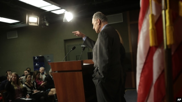 Sen. Charles Schumer, D-N.Y., accompanied by Sen. Kirsten Gillibrand, D-N.Y, calls on a reporter during a news conference on Capitol Hill in Washington, Friday, Jan. 4, 2013, to discuss Superstorm Sandy aid.