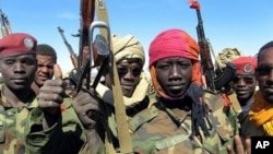 Children soldiers in the Chadian Army on the battlefield in Hadjer Marfain, east of Chad, after a fight against rebels. (File Photo - 14 Dec 2006)