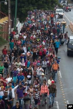 Honduran migrants walking to the U.S. start their day departing Chiquimula, Guatemala, Oct. 17, 2018.