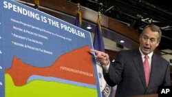 "House Speaker John Boehner of Ohio points to a chart to emphasize his point that government spending complicates the negotiations on avoiding the so-called ""fiscal cliff"" during a news conference in Washington, Dec. 13, 2012."