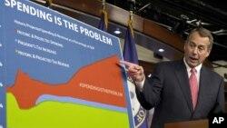 اسپیکر ایک چارٹ کے ذریعے ٹیکسوں اور اخراجات پر اپنی موقف واضح کررہے ہیں۔ 13 دسمبر 2012
