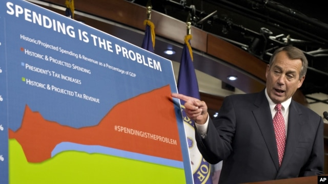 "House Speaker John Boehner of Ohio points to a chart to emphasize his talking point that government spending complicates the negotiations on avoiding the so-called ""fiscal cliff,"" during a news conference on Capitol Hill in Washington, Thursday, Dec. 13,"