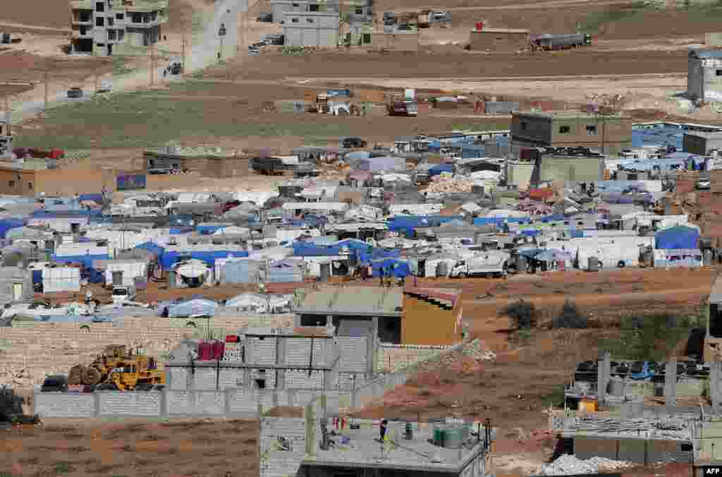 Tents house Syrian refugees in the city of Arsal in Lebanon's Bekaa valley, near the border with Syria.
