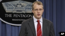 Pentagon Press Secretary George Little gestures during a news conference, December 22, 2011.