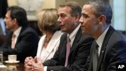 President Barack Obama sits with House Speaker John Boehner of Ohio, House Minority Leader Nancy Pelosi of California, House Majority Leader Eric Cantor of Virginia, as he meets with Republican and Democratic leaders regarding the debt ceiling in the Cabi