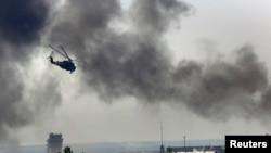 5月26日乌克兰一架军用直升机向占领顿涅茨克主要机场的亲俄分离分子开火