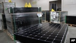 FILE - SunPower solar panels are stacked in Positive Energy Solar's warehouse in Albuquerque, New Mexico, March 9, 2016. The United States spent over $11 billion on issues related to climate change in 2014, according to U.S. goverment data.