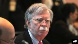FILE - U.S. National security adviser John Bolton, attends a conference of more than 50 nations that largely support Venezuelan opposition leader Juan Guaido in Lima, Peru, Aug. 6, 2019.