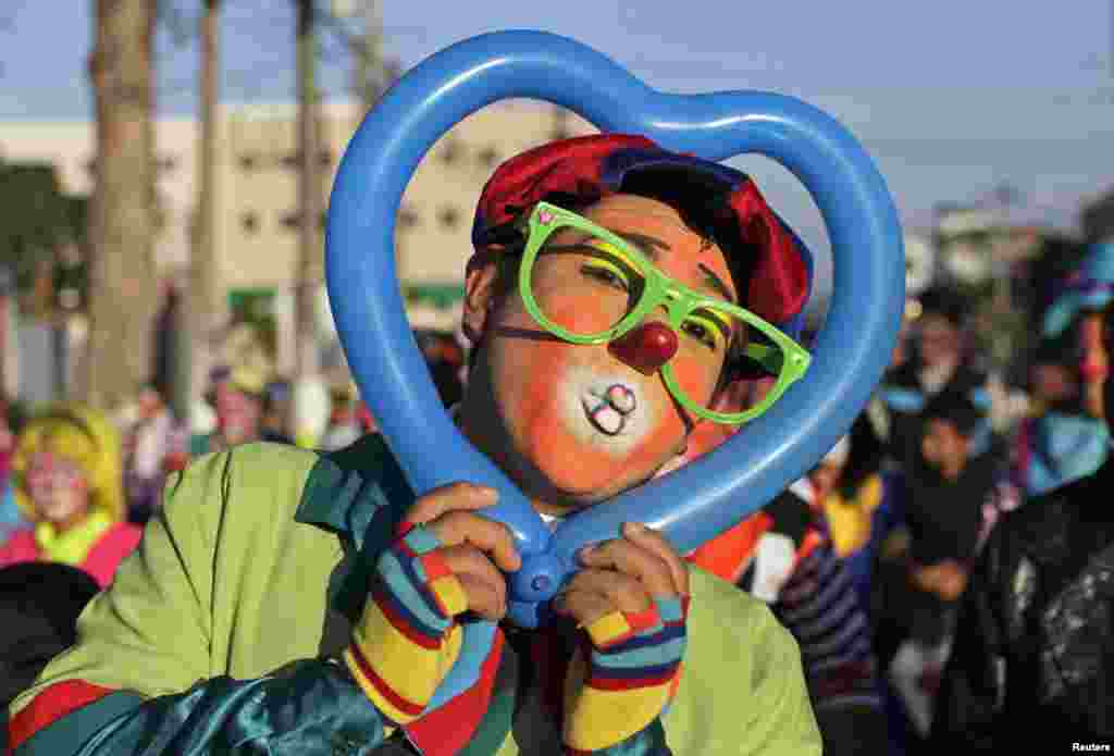 """A Salvadorean clown going by the name of """"Bobo"""" poses during National Clown Day celebrations at Beethoven Square in San Salvador, El Salvador, Dec. 3, 2014."""