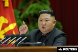 North Korean leader Kim Jong Un speaks during the 5th Plenary Meeting of the 7th Central Committee of the Workers' Party of Korea (WPK) in this undated photo released on Dec. 28, 2019 by North Korean Central News Agency (KCNA).